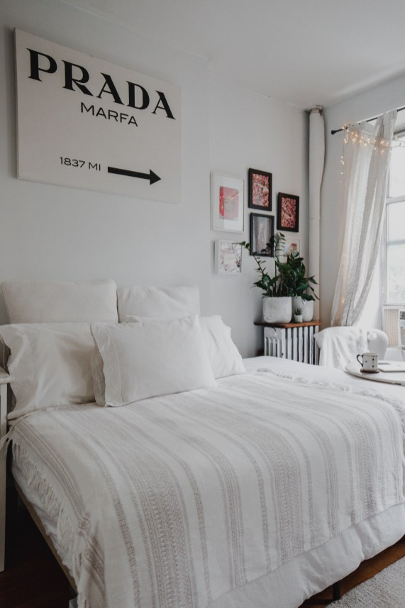 NYC apartment decor ideas. Designing small spaces new york city bedroom. White bedroom decor.
