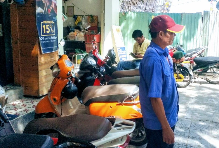 motorbike attendant Vietnam