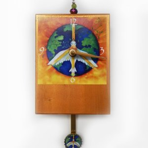 Peace Precious Time Clock has a peace dove flying over earth. the clock body is painted a deep gold. There is a small peace dove on bottle cap pendulum or a heart if you choose.