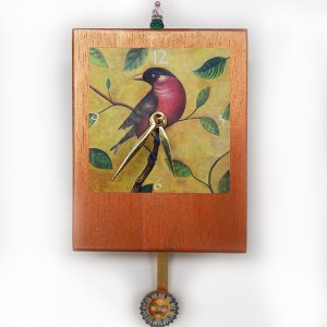 Robin Precious Time Clock has my robin red-breast image in a tree, over a copper colored wooden clock body- a sunshine face smiles in the pendulum.