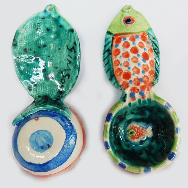"front and back Our handmade Fish handle Coffee Scoop is about 7 inches by 3,"" in colorful ceramic. The handle is a raised design of a fish. A smaller fish is in the bowl of the scoop."