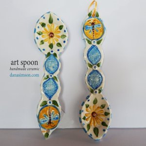 handmade  folk art Dragonfly & Daisy Ceramic Spoon is cut out, formed in clay and individually decorated using my handmade stamps. The raised imagery detail includes a daisy in the spoon area and dragonfly on the handle.