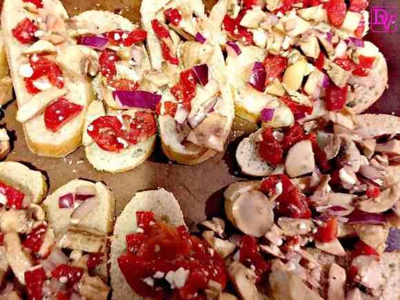 bruschetta, red onions, antipasti, olive oil, roasted red pepper, red pepper, red peppers, roasted red peppers, feta, mushroom, sliced mushroom, oven, baked, garlic, salt, pepper, appetizer, food, food blogger, foodie, dana vento, dana vento food blogger, Red Pepper and Feta Bruschetta