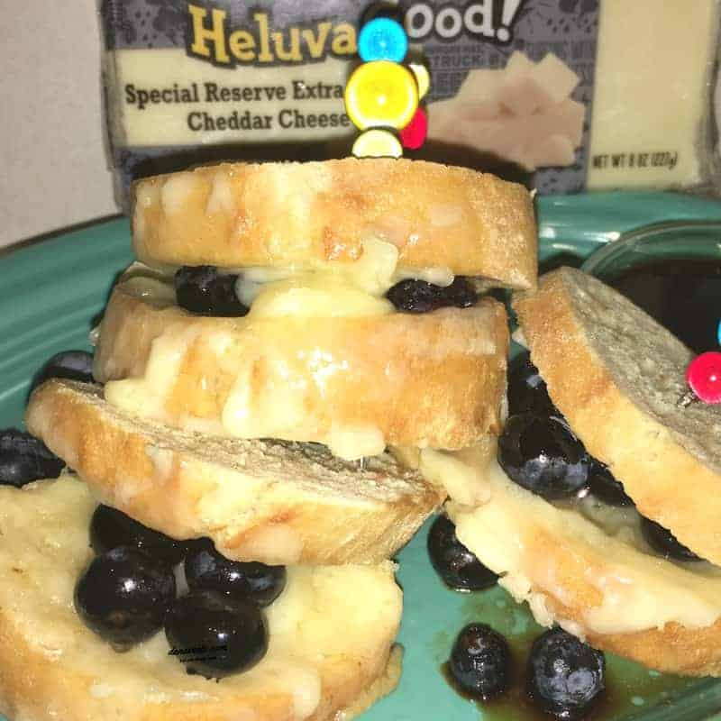 Special Reserve Extra Sharp Cheddar Grilled Cheese Bites with Blueberries, Cooking, food, homemade, artisan, food prepared, prepared at home, how to, food diy, recipe, food recipe, food instructions, how to cook, food prep, greens, meatless, meat, food post, recipe post, diy post, kitchen, hands on, yummy, delicious, green and mean, fabulous food, easy to prepare, at home preparation, food prep in your home, you are the chef, go you, cooking recipes, edible, good eats, yummy, instant food, instant good, meals at home, dinner, lunch, side dishes, picnics, parties, Cheese, Heluva Good!, Blocks, chunks, slices,sandwiches, grilled cheese, cheese bites, balsamic, picks, bread, baguette, bite size, easy, party food, fast, Fork, knife, spoon, plate, cup, napkin, paper napkin, cloth napkins, table clothes, placemats, set table, table and place settings, clear table, set table, forks and spoons, bowls, serving platters, food prep, presentation of food, food setting, set up table, clear table, party table, everyday table, table and linens, table and chairs,