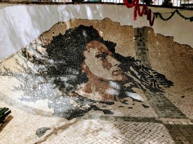 This mosaic is of the Queen of Fado music- Amália Rodrigues. Because of the different types of stones, when it rains, she cries.