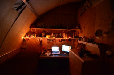 My room in my tent. It is approximately 8x9. I have the Christmas lights & a small lamp as my primary lights. I prefer it to be dim; the overhead light is just too bright.
