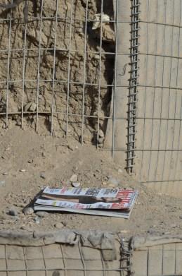 An abandoned magazine on the HESCOs