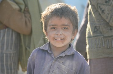 A young boy smiles for the camera in Shah Joy