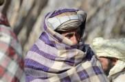 Bundled against the biting wind in Haji Sultan