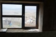 Qalat City through a broken window
