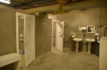 The toilet side of the latrine building