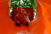Kennadi helping Sam down the slide