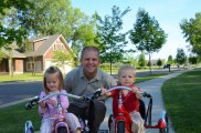 The little kids with me & their new trikes when I was home on leave