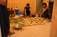 In the 'kitchen' getting the plates ready to serve...yes, they are sitting on the plywood floor just inside the door.