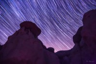 Still Rocks Against a Circling Sky star trail photo of Paint Mines Colorado by Dan Bourque