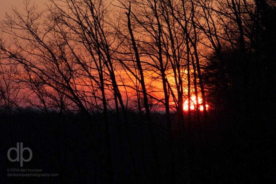 Orange Sun Peeking Through the Woods landscape photo of Kentucky by Dan Bourque
