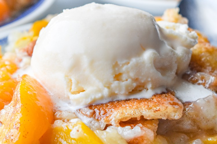 Easy Peach Cobbler on a plate with ice cream