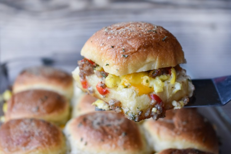 Hawaiian Roll Breakfast Slider being scooped out of a pan.