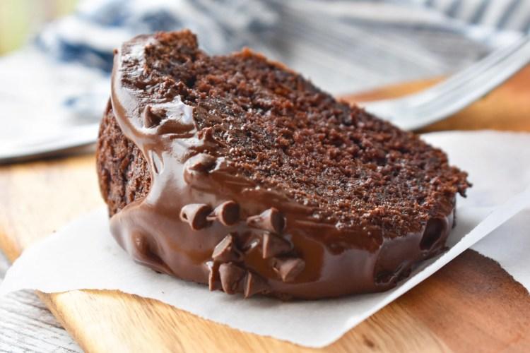 Moist Chocolate Bundt Cake slice on parchment paper
