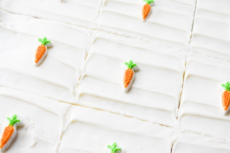 Cream Cheese Frosting with carrot candies on top