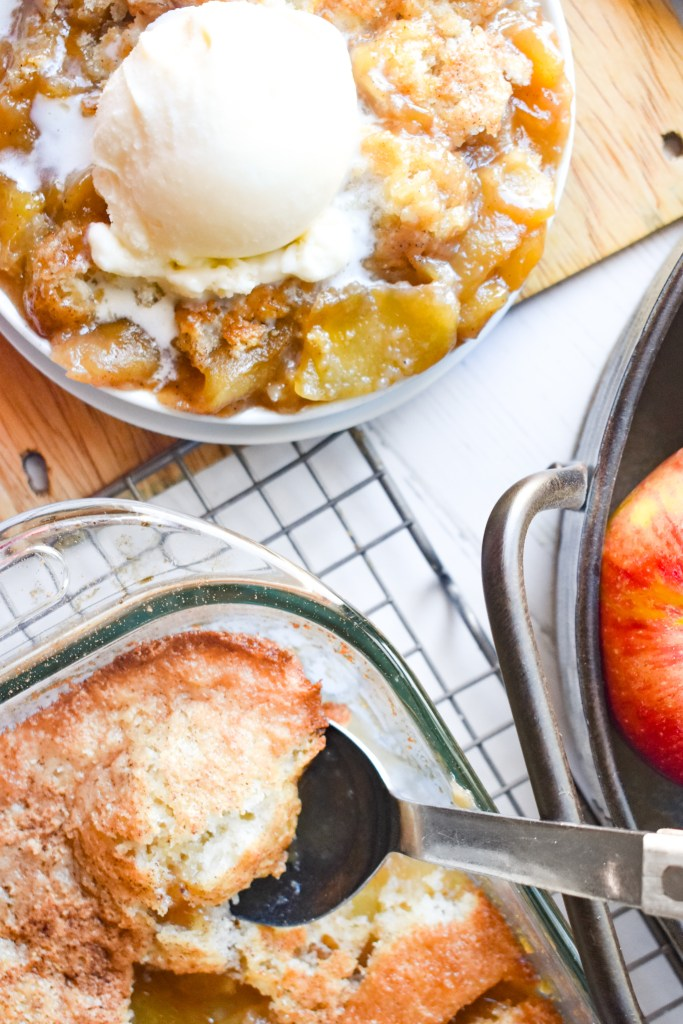 Caramel Apple Cobbler in a baking dish and on a white plate