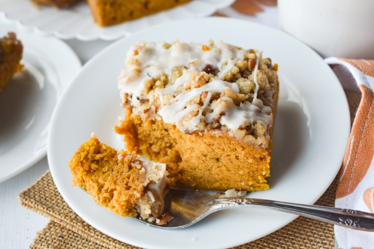 Slice of pumpkin coffee cake with a  forkful taken out