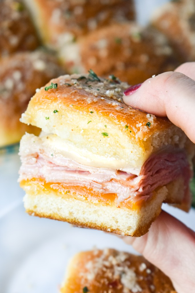 Ham and Cheese Slider being held in a hand
