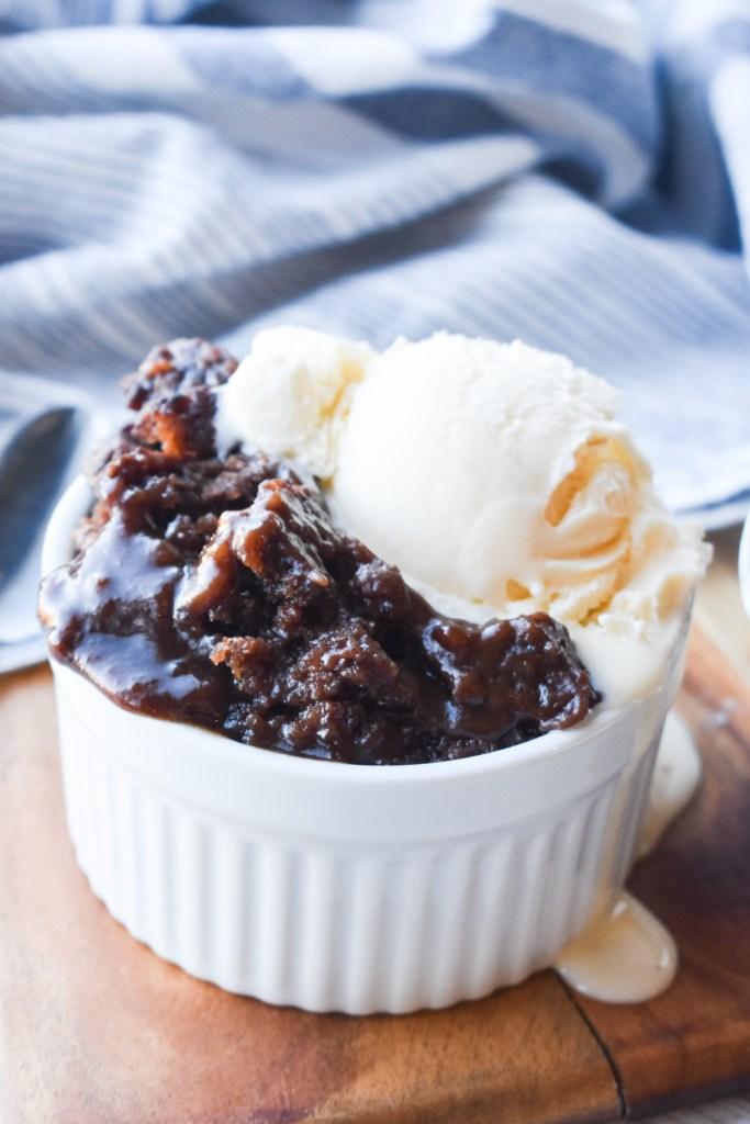 Chocolate Cobbler with ice cream in a white ramekin