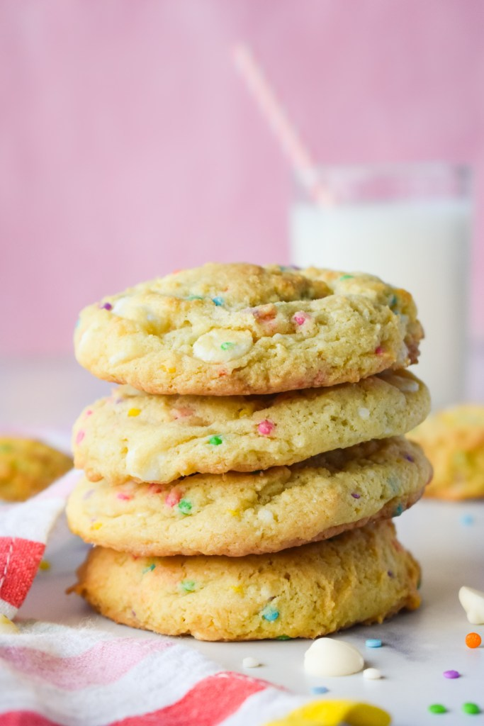 Stack of funfetti cookies with milk