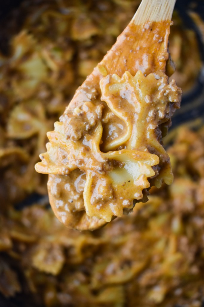 Wooden spoon with Cheeseburger Pasta Skillet close-up