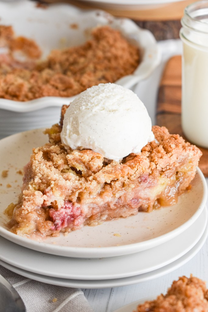 Slice of Rhubarb Pie on a white speckled plate