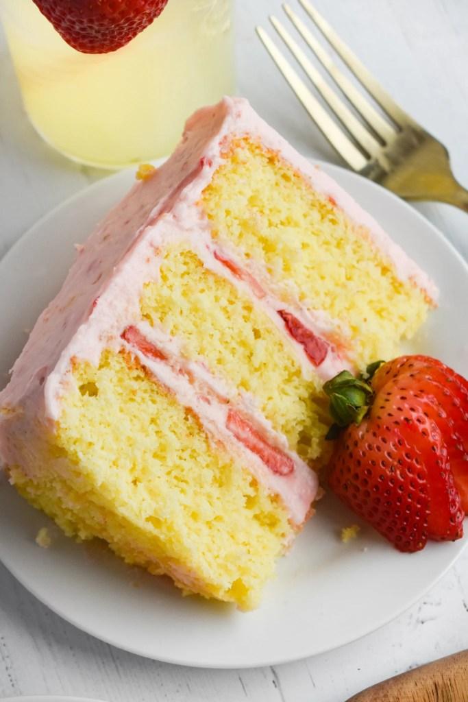 strawberry lemonade cake slice on a white plate