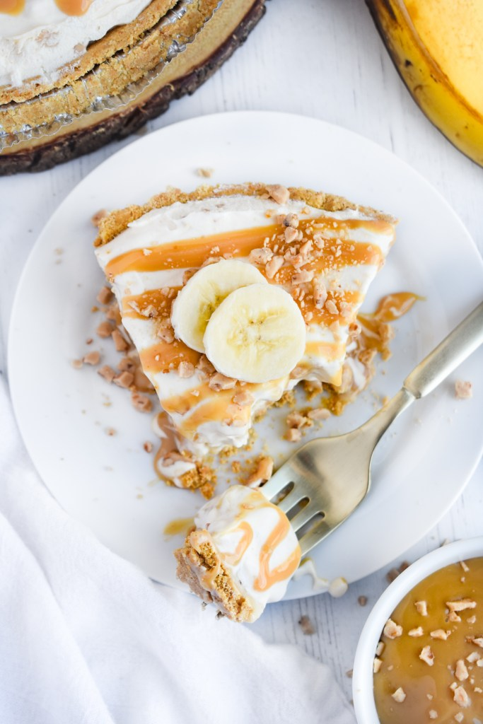 Birdseye view of banoffee ice cream pie with a forkfull out of it