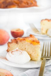 slice of peach upside down cake on a white plate