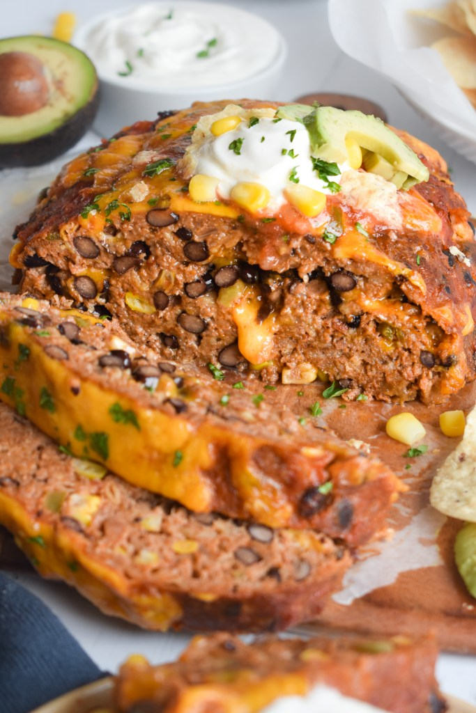 sliced Mexican meatloaf with cheese oozing out