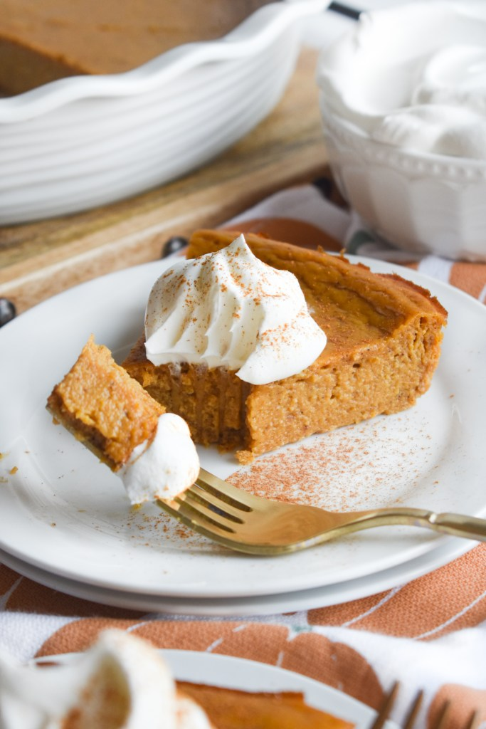 crustless pumpkin pie on a fork with whipped topping