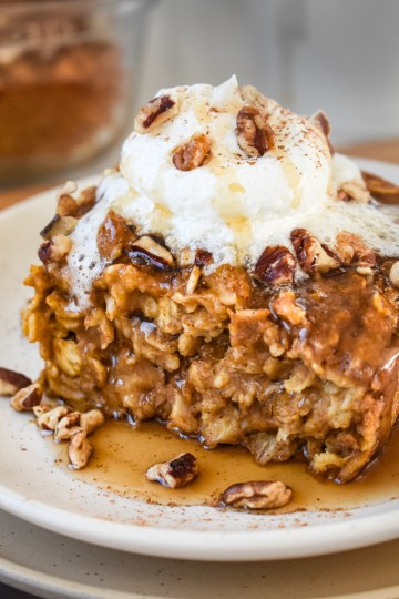pumpkin baked oatmeal with a dollop of whipped cream
