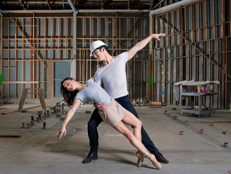 Two dancers, Terez Deen Orr and Peter Kurta, in a dance pose in the intereior of the new Smuin Ballet building.