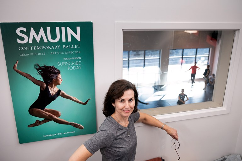 Celia Fushille, in front of a poster for Smuin Contemporary Ballet, of which she is artistic director.