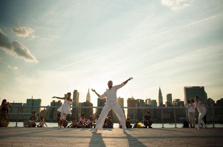 Dance Entropy dancers perform in Long Island City with Manhattan skyline in the background.