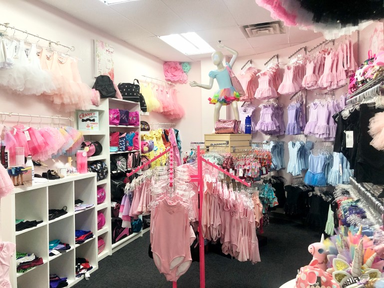 Pink and mauve dance leotards and skirts for tiny dancers displayed together at Nathalie & Co store in Phoenix