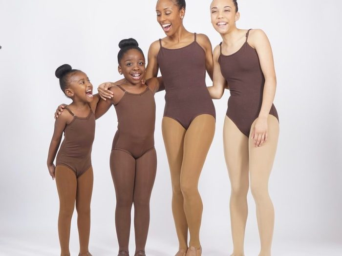 4 dancers with various shades of fleshtone leotards, tights and shoes.