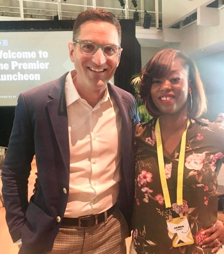 Guy Raz from How I Built It with Guy Raz, in shirt and jacket, and Jamia Ramsey, in flowered blouse.