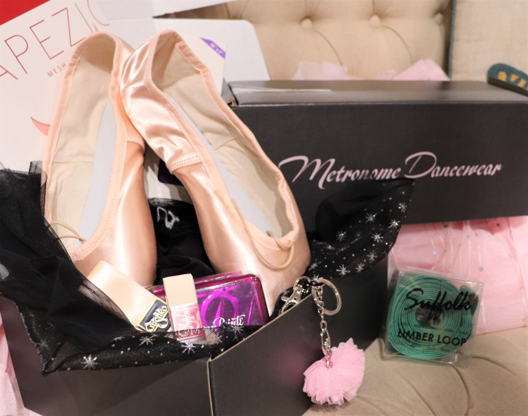 Box with pointe shoes, pointe shoe ribbons, ballet keychain, from Metronome Dancewear