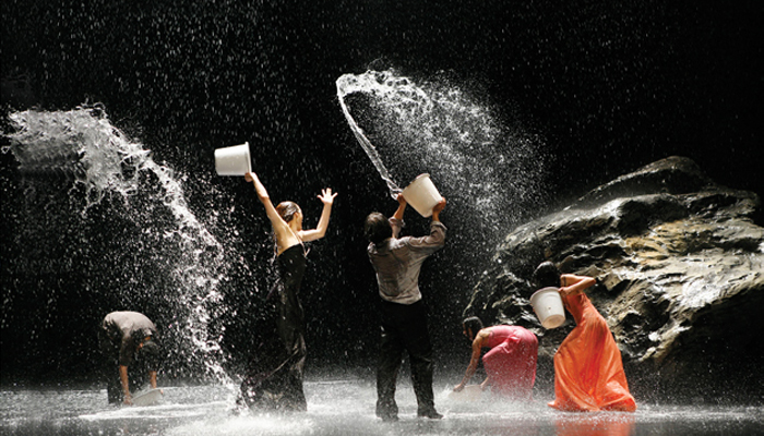 Artists of Tanztheater Wuppertal in Pina Bausch's Vollmond  Photo: Laurent Philippe