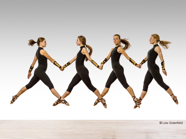 Trinity Irish Dance Company dancers Alesandra Doughty, Maggie Doyle, Erin Gradus, Chelsea Hoy, Sierra McNall, Sydney Niewiedzial, Aaron Wolf, Margaret Nowakowski, Marissa Wurster (Photo by Lois Greenfield Dance)