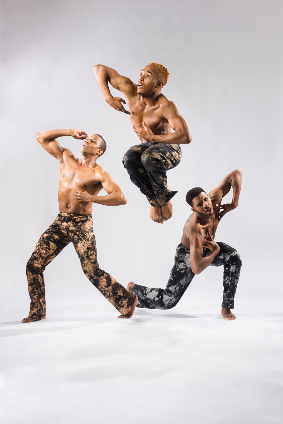 """Deeply Rooted Dance Theater's Pierre Clark, William Roberson and Joshua Henry in Joshua L. Ishmon's """"When Men"""" (Photo by Ken Carl)"""