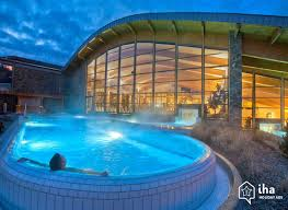 Relaxing in a hot tub helps ease muscle stiffness.