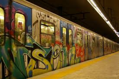 It's difficult to see graffiti-covered subway car.