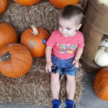 this past halloween logan sat in a pumpkin patch